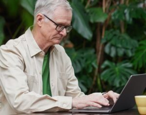 Elderly man looking at a computer